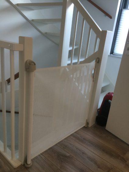 Traphekje oprolbaar aan trap